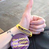 A close-up of a Union member's hand giving a thumbs-up.